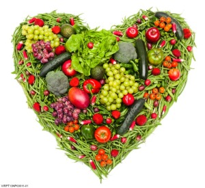 Heart made of assortment of vegetables and fruits